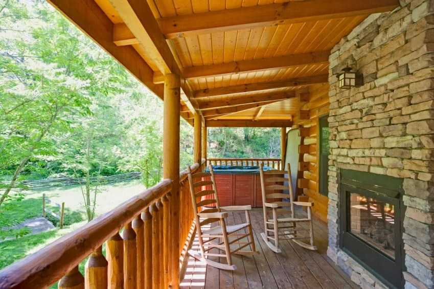 With an ideal combination of bricked wall, wooden ceiling and railing, this porch gives summer feels as the open space allows in the gleaming sunlight.