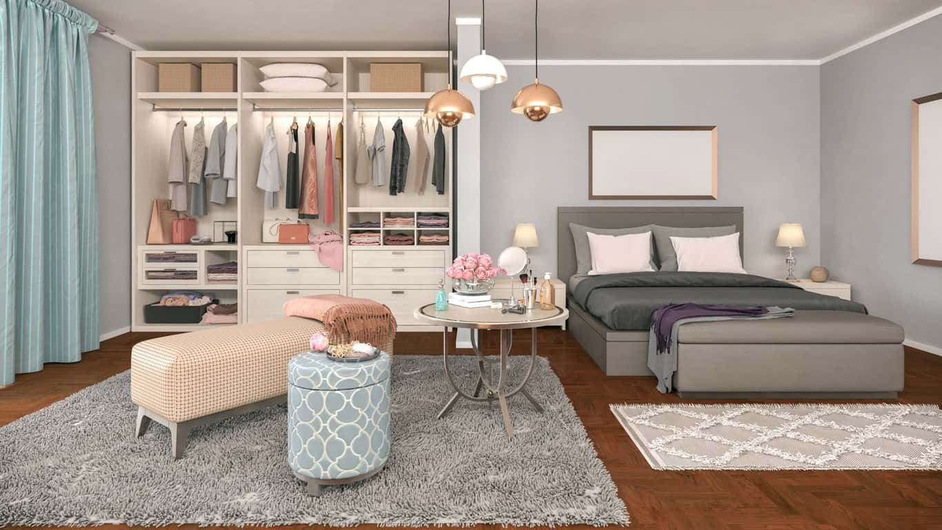Modern women's closet just beside her bedroom's primary bed. The white cabinetry with a lighting installed looks just simple yet lovely.