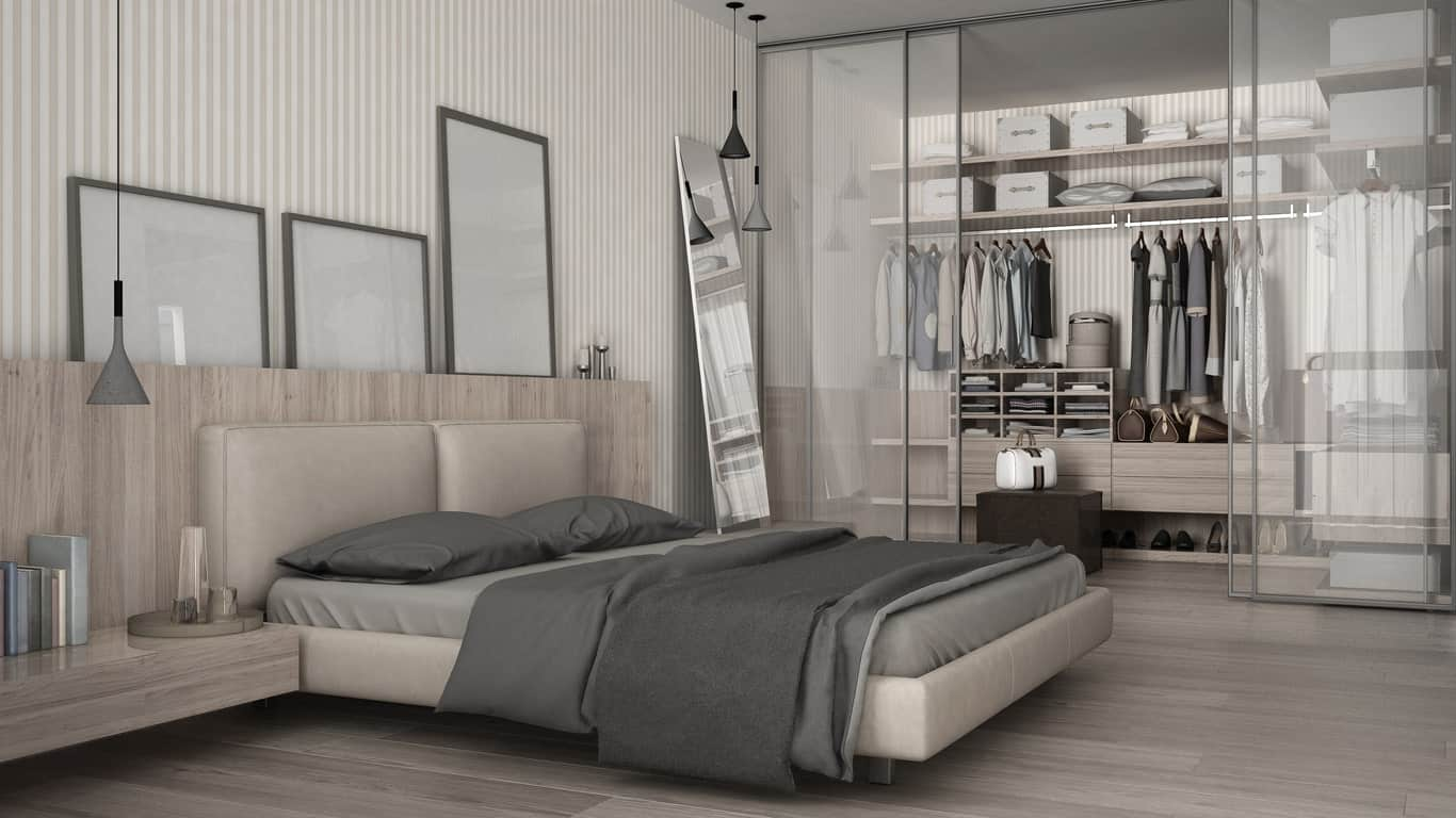 This stylish modern women's closet is just beside her bedroom. The closet boasts a set of sliding glass doors leading to the bright cabinetry.