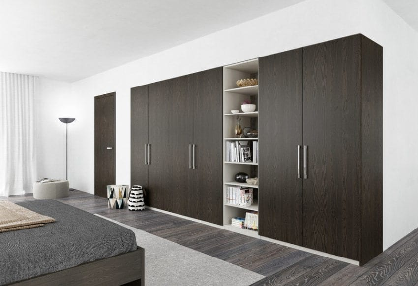 Deep dark solid colors always exude sophistication and classiness. These modern closets consist of minimal design; the doors are made of dark brown, almost black, wood, while the interior is snowy white and provides a dramatic contrast. The inside of the closet is multi-tiered so it can store plenty of things of all shapes and sizes. The dark exterior also provides a theatrical look against the bright wide backdrop of the walls.