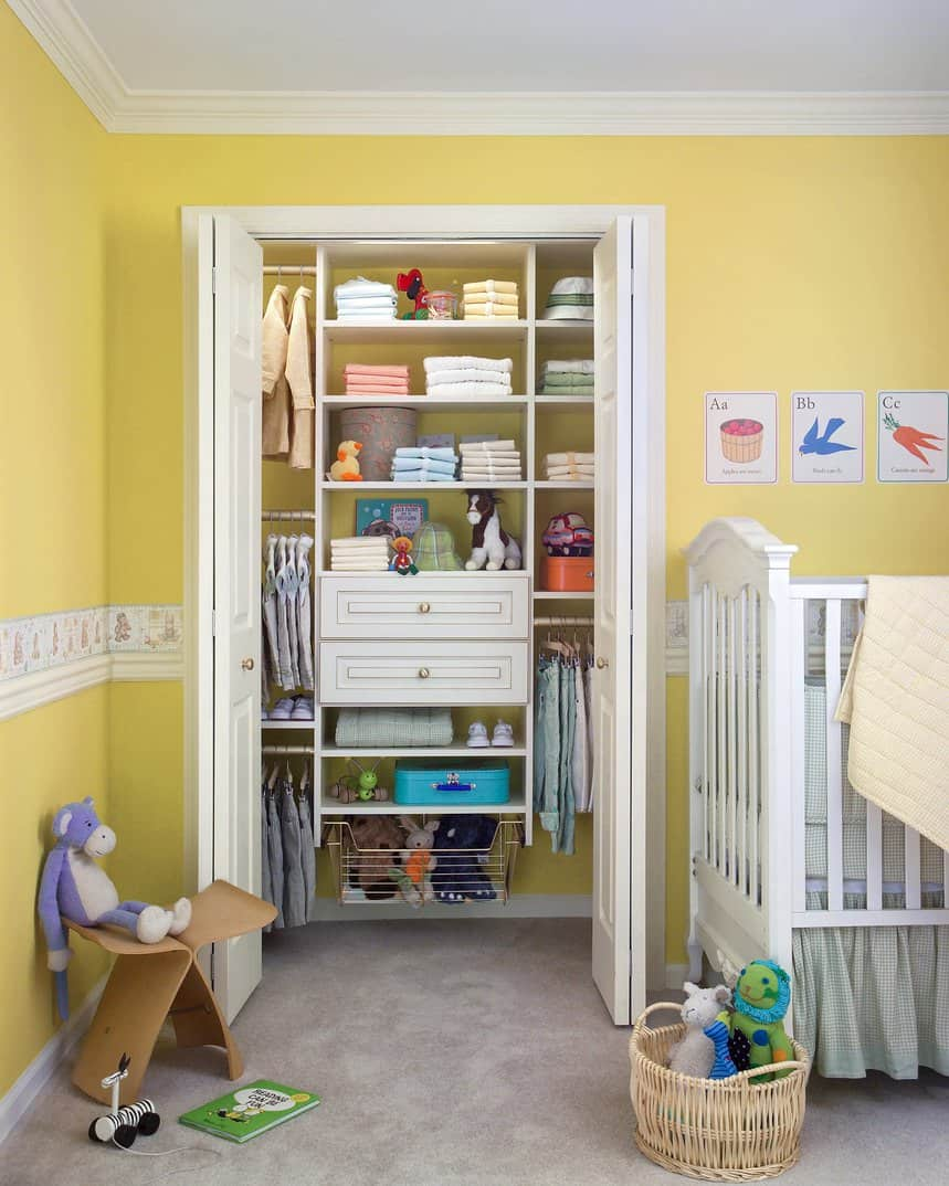 We can't guess whether this little closet belongs to a tiny boy or girl, just based on the cute little clothes in lovely pastel colors arranged inside it or the sunny yellow walls. But what we can say is that the closet is a treasure trove of plush toys for the room's little occupant.