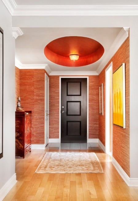This foyer combines the red, white and walnut colors, and it looks so beautiful. The ceiling is just stunning.