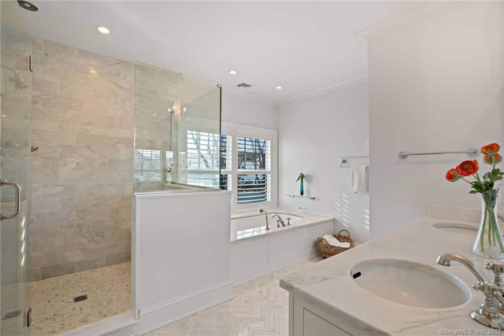 Check out that primary bathroom with walk-in shower and jacuzzi tub alcove.