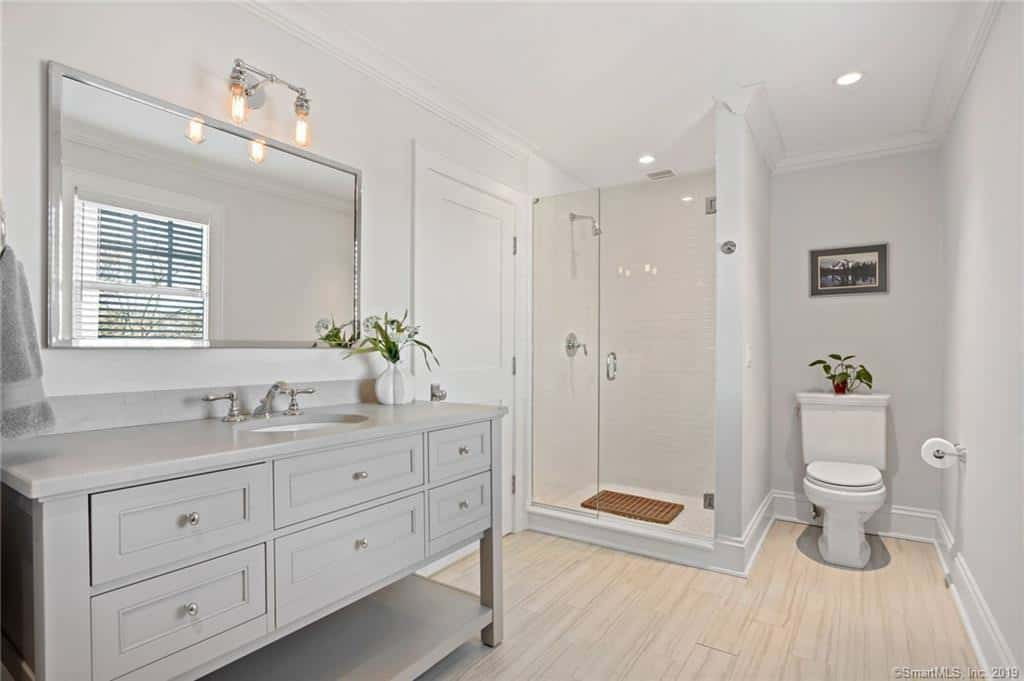 The guest bathroom easily qualifies as a primary bathroom.  It's very nicely appointed with custom vanity and glass shower.