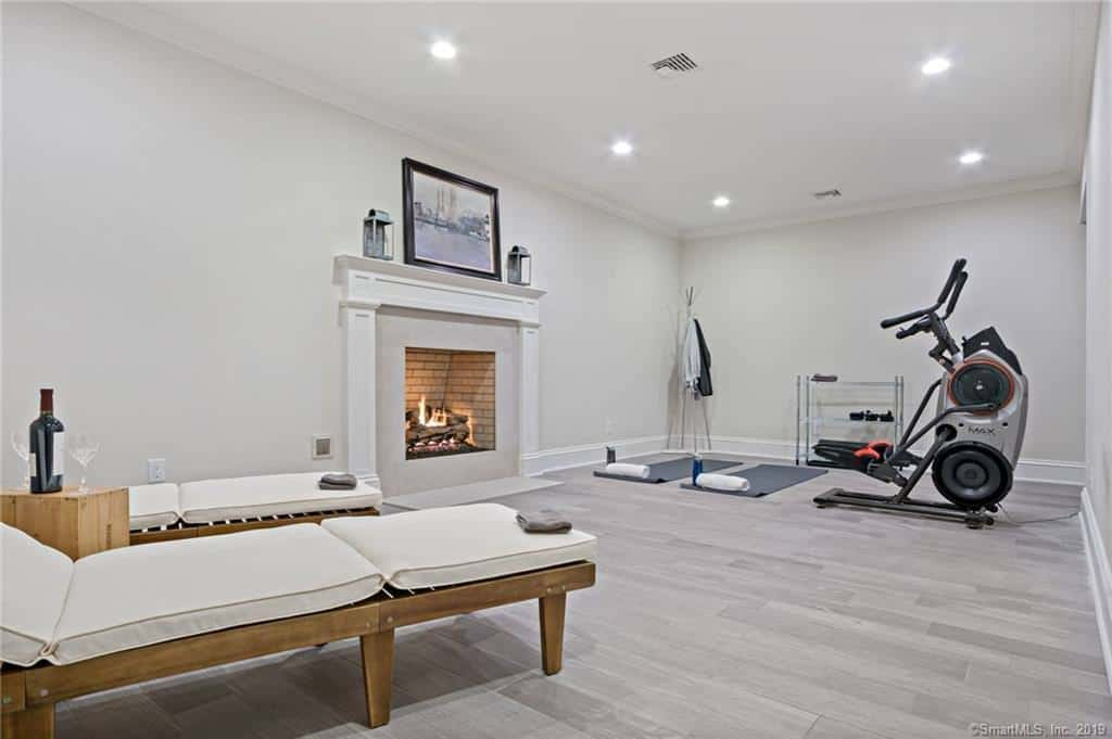 And yet another room serves as a home gym and lounge area.