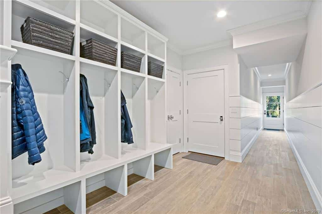 The other entry is a large mudroom with custom built coat lockers situated off the hall to the other entry door.