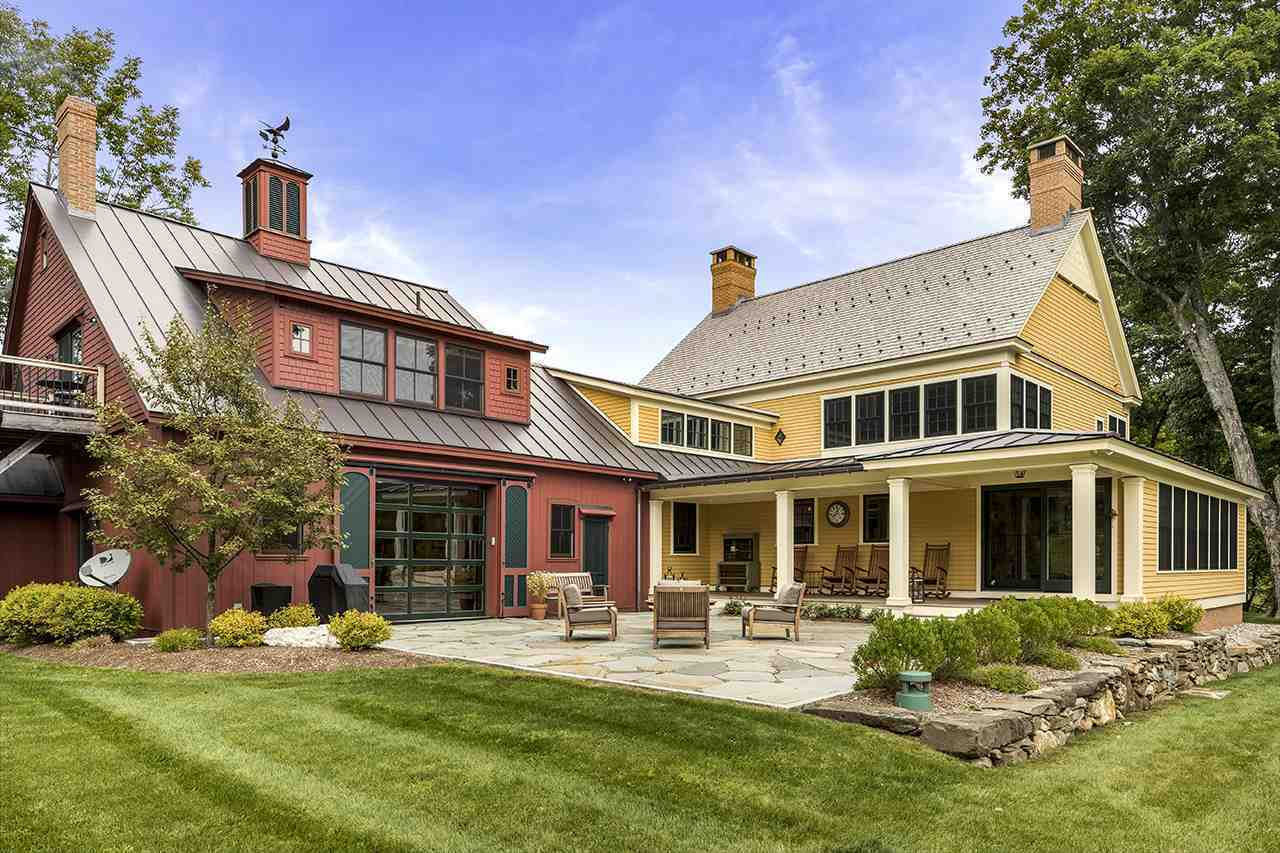 Red and yellow rustic house in the Vermont countryside