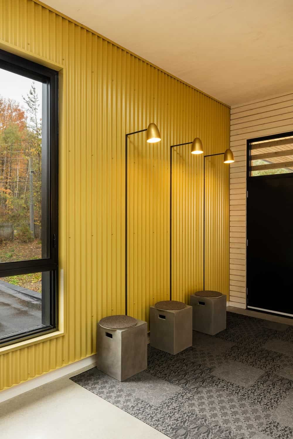 Modern yellow foyer in house designed by Tux Creative