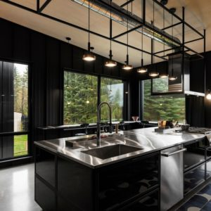 Very cool black kitchen design by Tux Creative