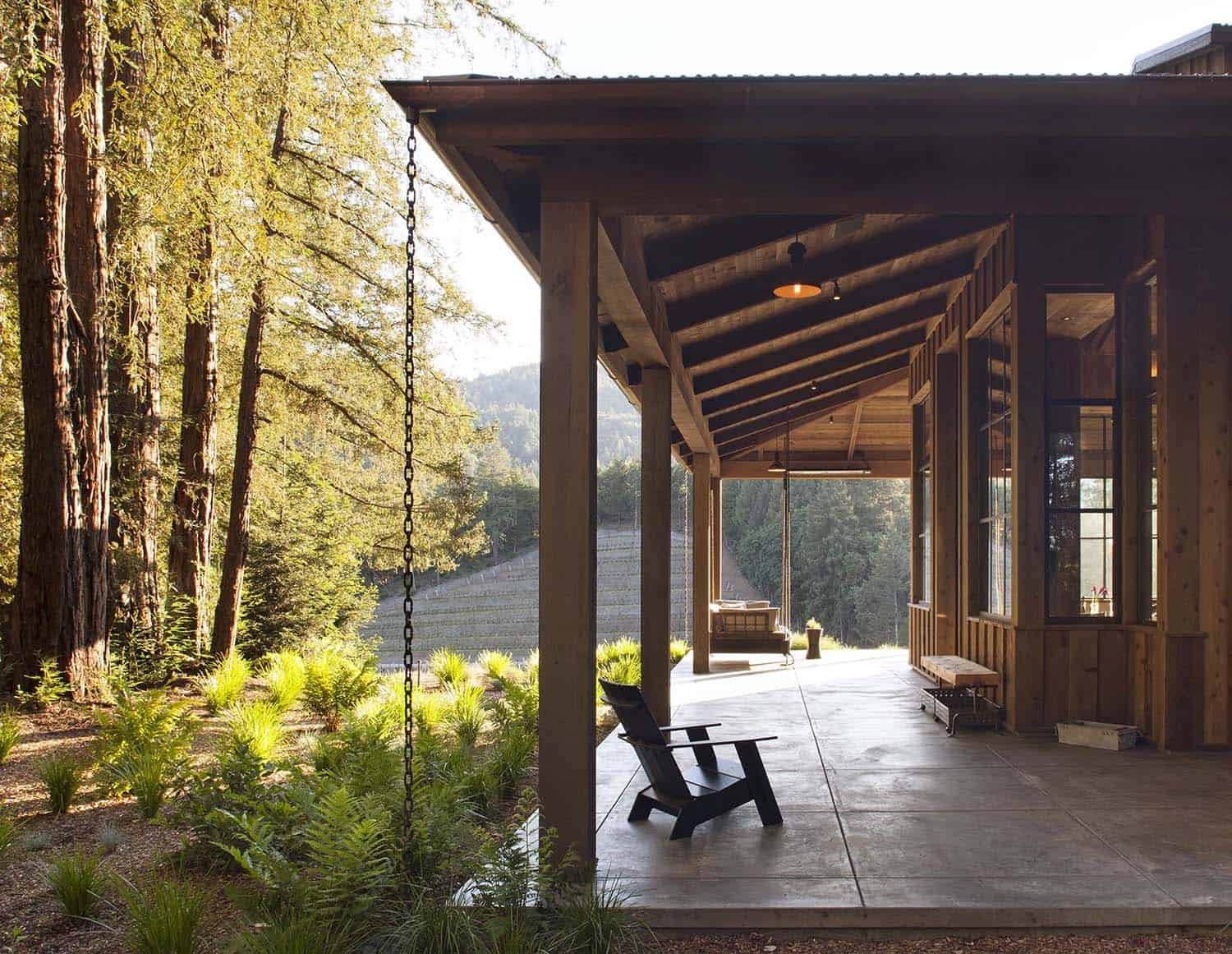 The home enjoys a wrap-around porch with views of the vines as well as looking out into the serene forest.