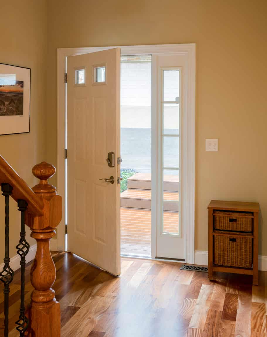 Small foyer featuring a hardwood flooring and beige walls.