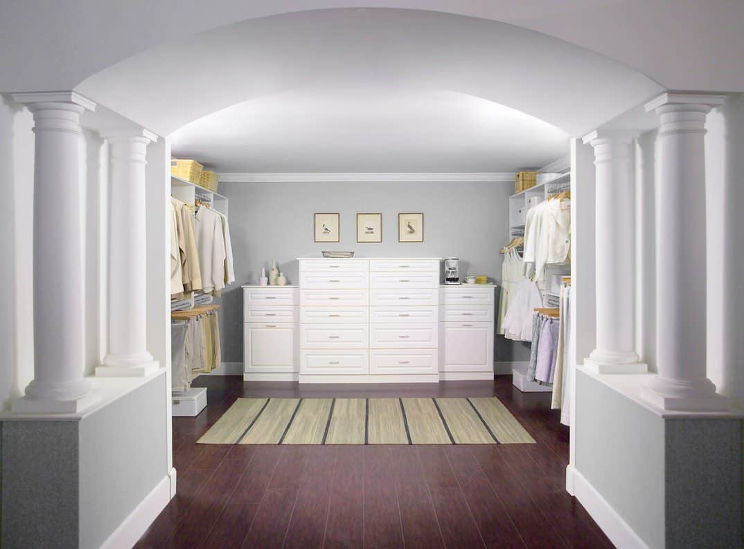 Besides providing the essential storage space, this walk-in closet is more about grandiose. The pristine white-wash walls and Roman-style pillars that contrast against the deep hazelnut wooden floor add a stately beauty to the house in a subtle way.