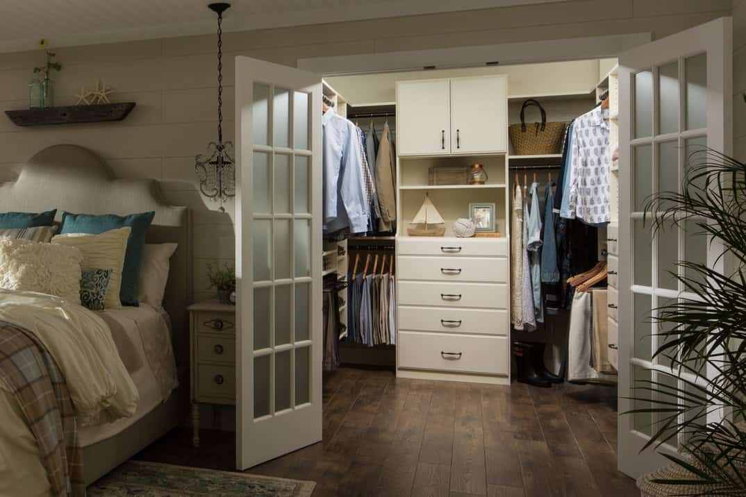 Simple and practical are two words that best describe this walk-in closet. Everything looks neat and tidy arranged in a proper way, but if you prefer, the closet can be hidden from view by closing the double French doors.