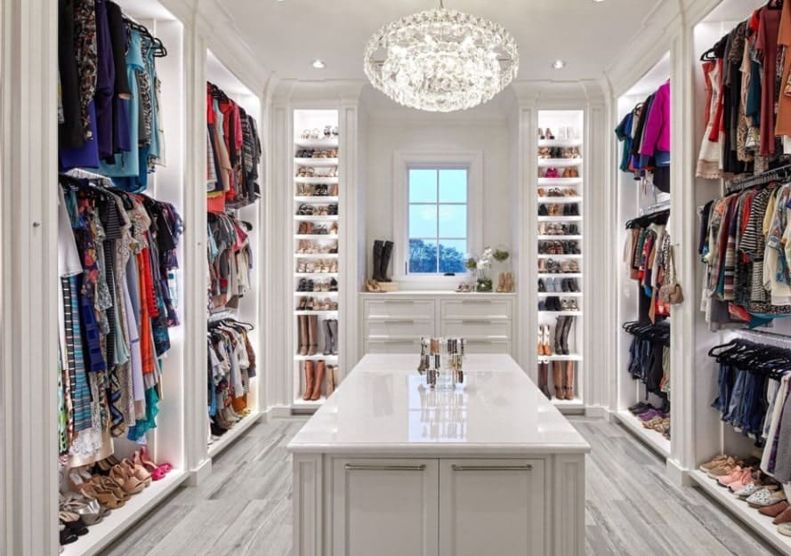 Trouble selecting an outwear each day? Consider a great walk-in wardrobe like this to have every option visible at a glance. Keep the shelves and everything white to avoid a stuffy and cluttered look.