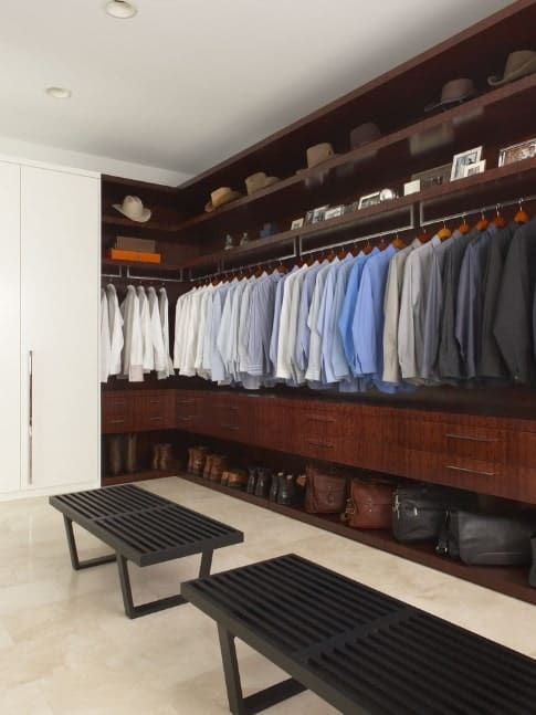 This black and brown walk-in wardrobe is perfect for rowdy cowboys and all men who seek a masculine design for their closets.