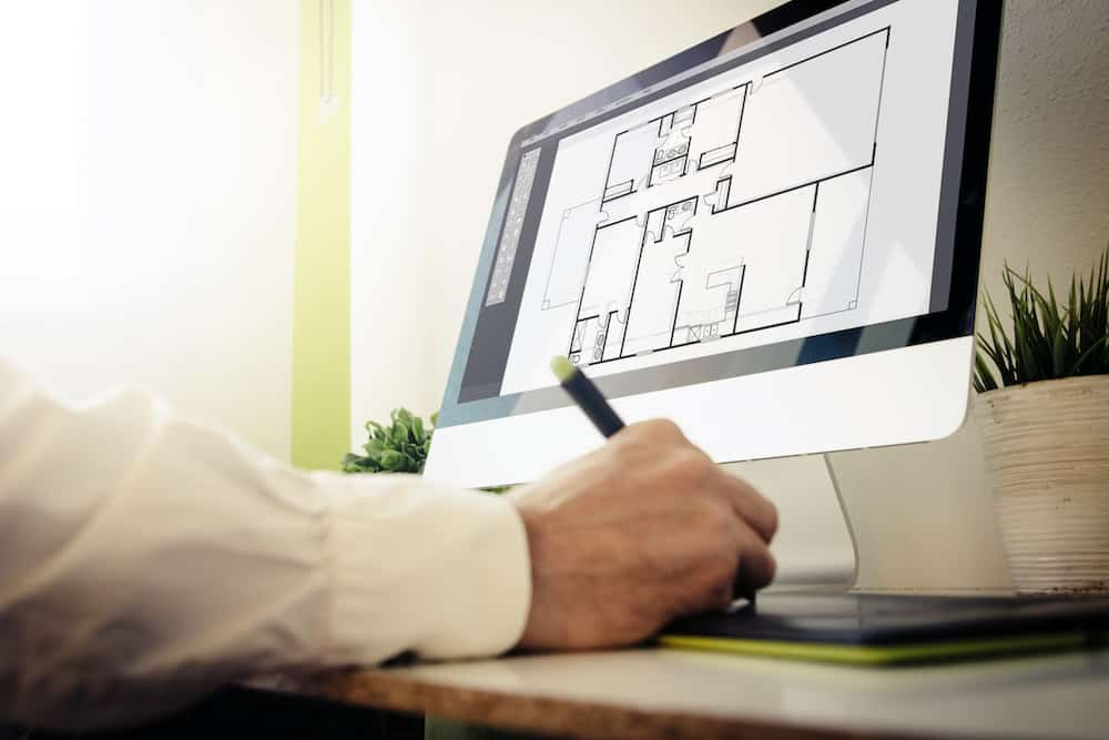 Architect using best design software to design a building