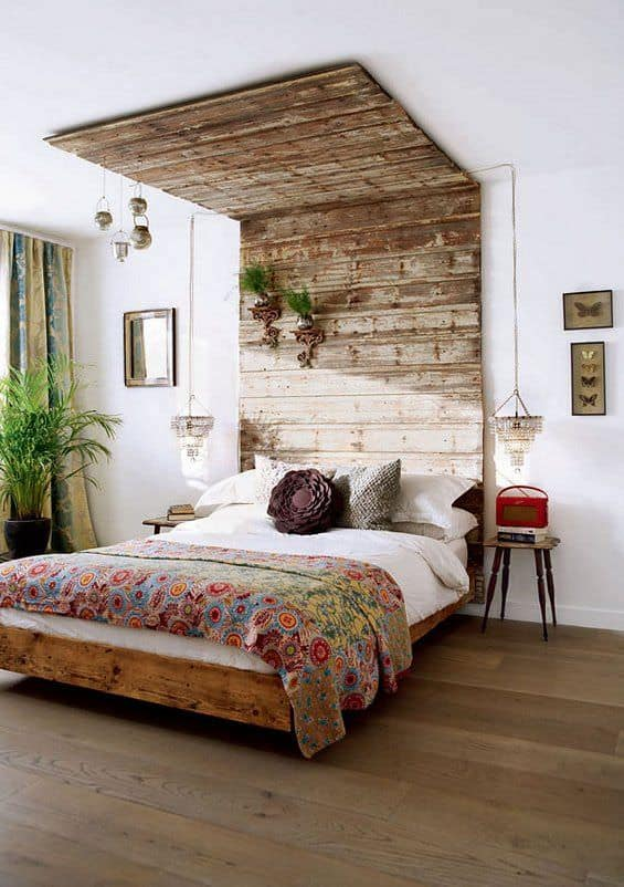Check this out - it's a pallet wood headboard doubling as accent wall and even accent ceiling.