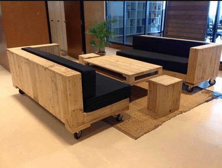 Matching set of sturdy pallet sofas on wheels with matching coffee table