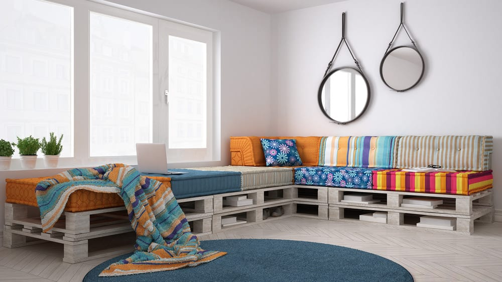 Corner pallet sectional with storage and multi-colored cushions