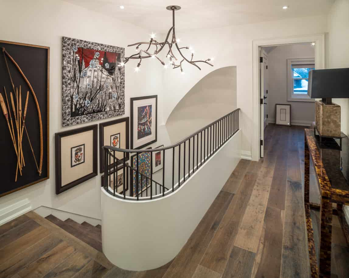 Upper landing with chandelier at top of stairs leading to hallway
