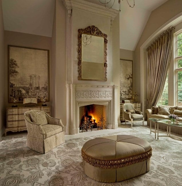This living room features a classy flooring and seats. The curtains look grand together with the fireplace.