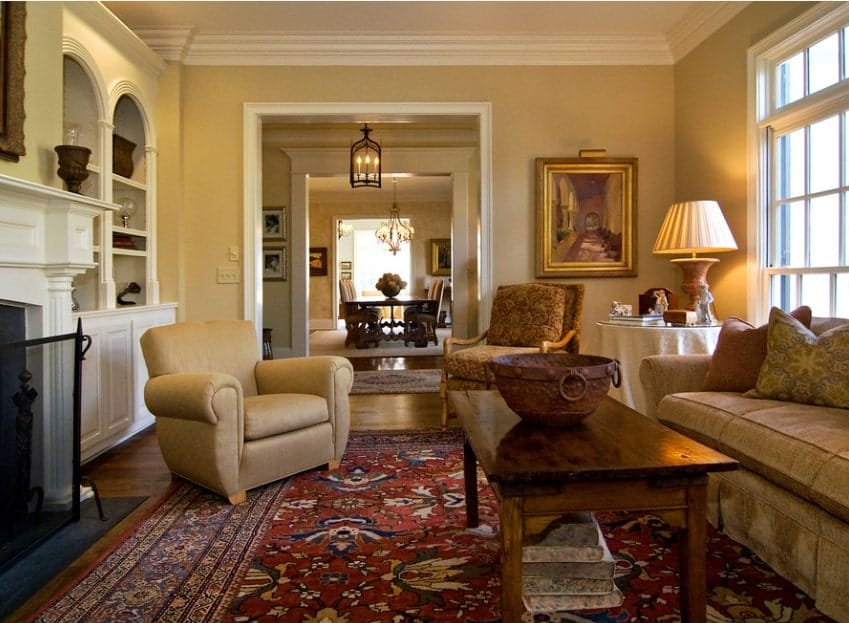An elegant living room featuring a glamorous set of seats on top of a lovely rug.