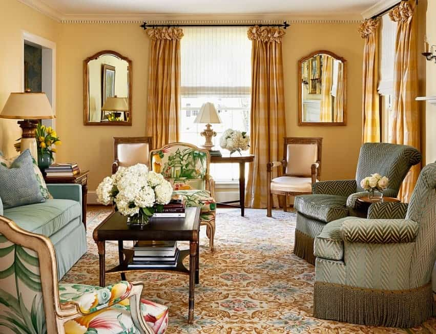 This living room is surrounded by elegant furniture sets along with hardwood flooring and window curtains.