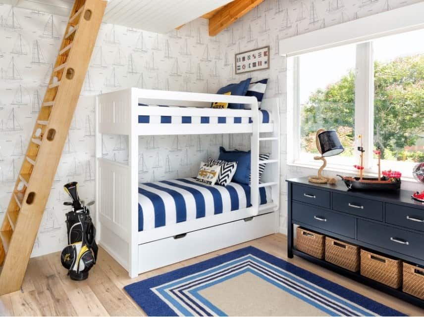 This boy's bedroom features a small bunk bed with stylish walls and classy hardwood flooring topped by a rug.