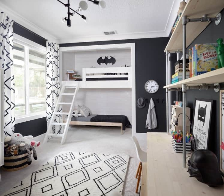 This boy's bedroom boasts Batman-inspired bedroom design with stylish beds and elegant black walls.