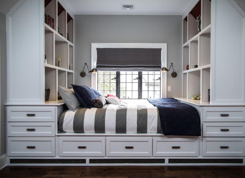 This boy's bedroom features bed, shelving and cabinetry combo, along with wall lighting and hardwood flooring.