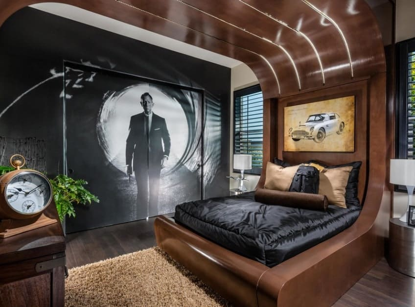 This James Bond-inspired with vintage flavor boy's bedroom looks very stylish. The bed is stunning along with the hardwood flooring.