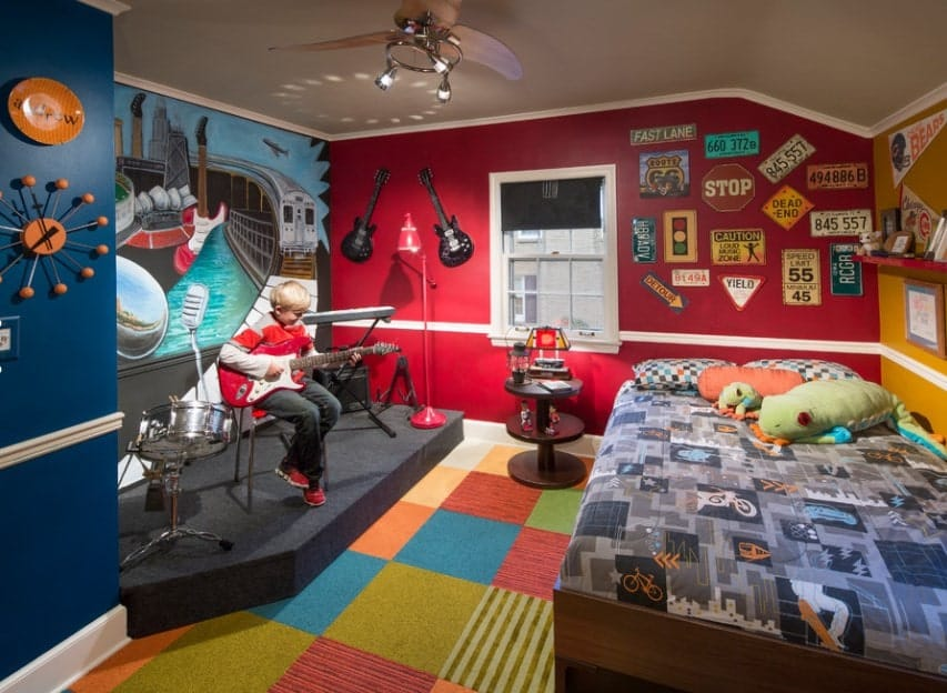 This boy's bedroom boasts music-friendly space and multiple stylish wall designs. The colorful flooring looks perfect together with the room's style.