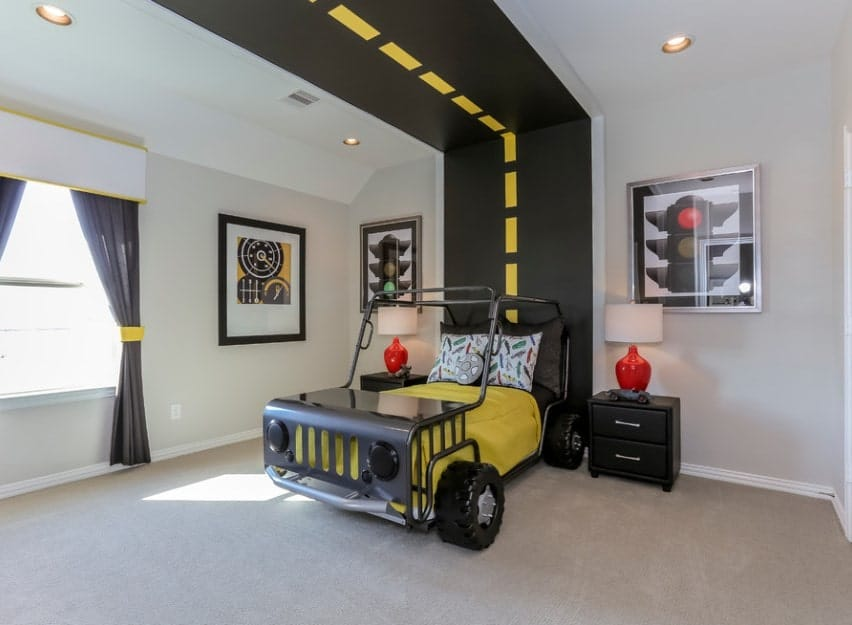 This boy's bedroom features highway-inspired wall designs and bed. The carpet flooring looks perfect together with the black finished side tables.
