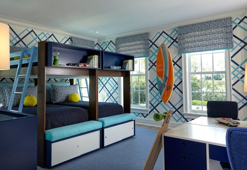 This boy's bedroom features blue shade and stylish walls with surfing board design. The bed looks very stylish as well.
