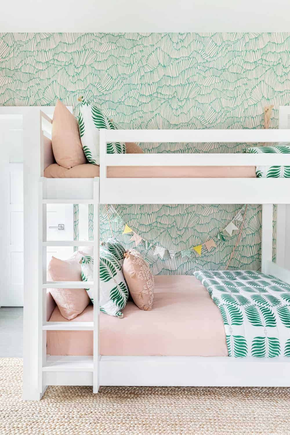 A close up look at the kids' bunk bed featuring a white, beige and green color scheme.