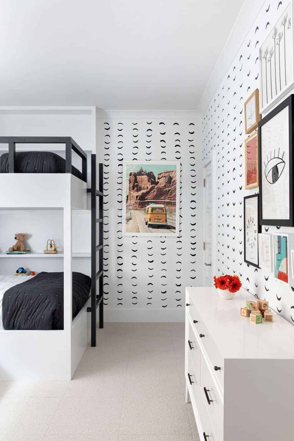 This kids' bedroom features stylish black and white bunk beds and attractive wall design as well.