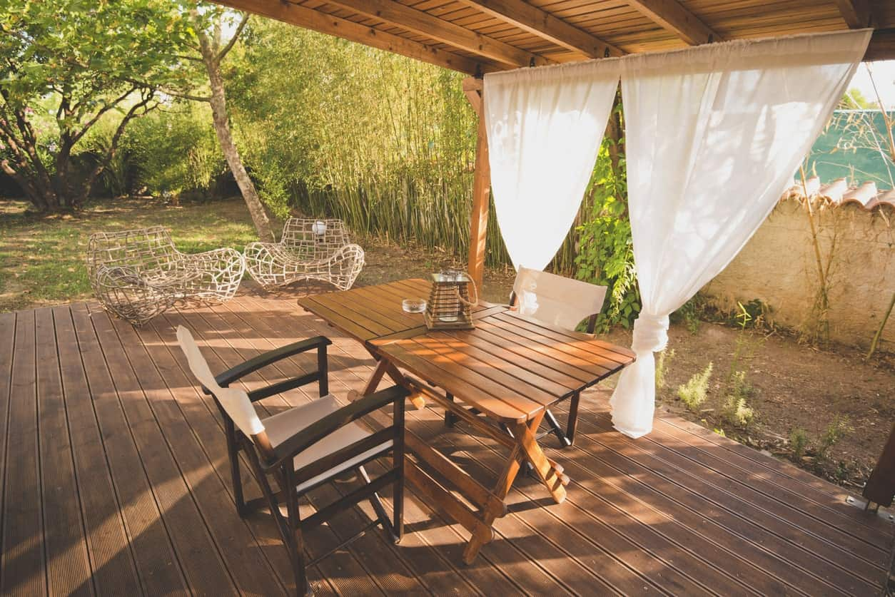 Lovely covered deck with a romantic dining table set for two.
