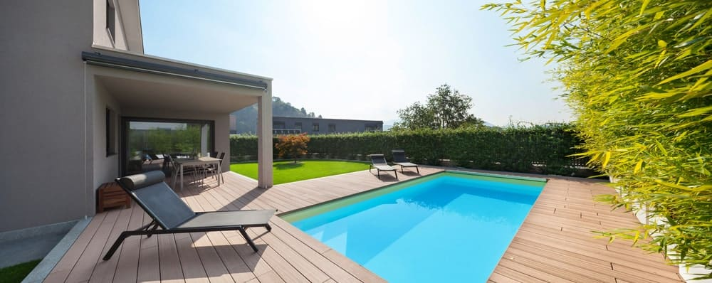 This large deck with lounger seats surrounds the swimming pool.