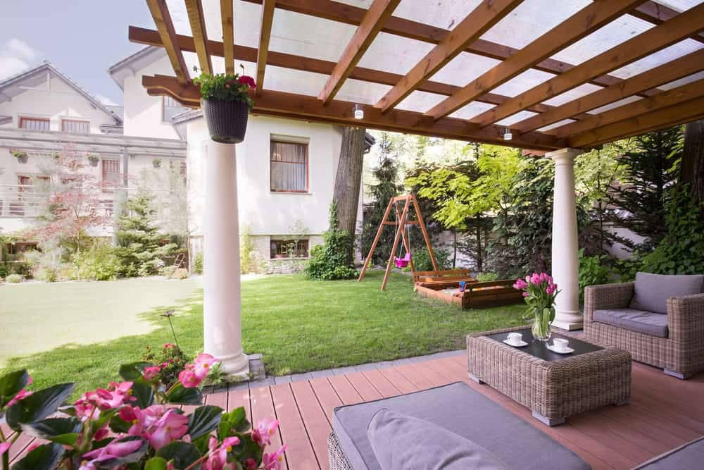 This deck is set on the garden's corner. The rattan furniture with cushion seats and foam backrests look stunning.