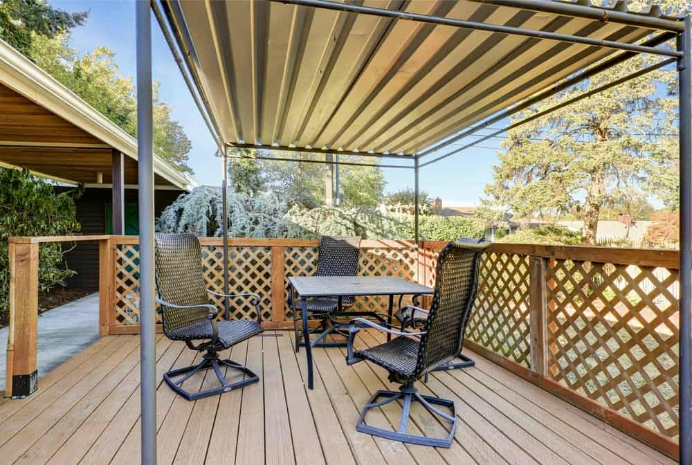 This deck features modern seats and table.