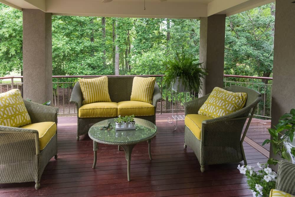 This deck offers rattan seats and center table set on the rustic flooring.