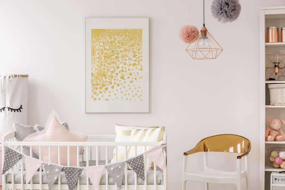 Nursery room with white walls with interesting wall decor.