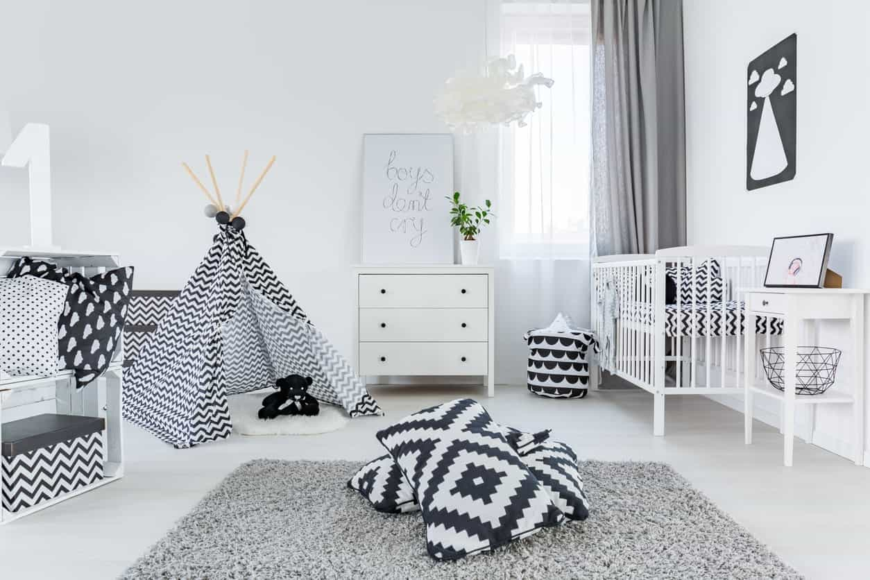 Modish nursery room with black and white shade along with a smooth vinyl flooring.