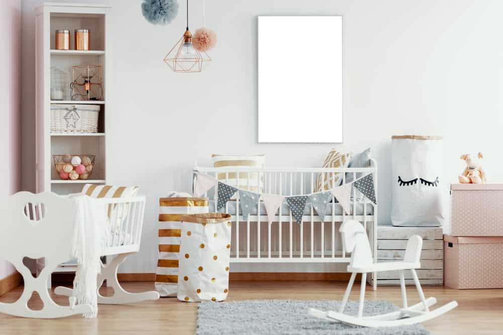 Nursery room with white and pink shade along with a smooth vinyl flooring topped by a rug.