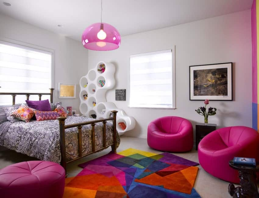 This girl's bedroom boasts interesting room designs and seats, along with the colorful rug. The bed looks very classy as well.