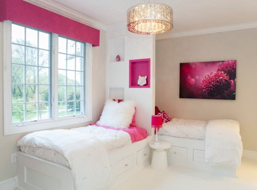 This girls bedroom features lovely beds that are perfectly placed, together with stunning wall decor. The pink shade adds class to the girls' room.