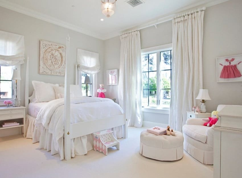 This girl's bedroom offers a white bed, matching with the white carpet flooring, white walls and white window curtains. The other furniture in the room are finished with white as well.