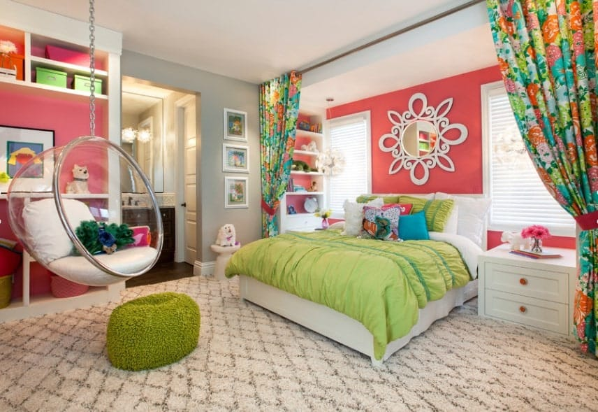 Large girl's bedroom with carpet flooring and lovely curtains. There's a swing made of glass, adding style to the bedroom.