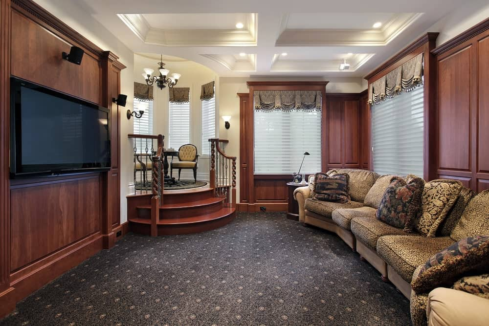 This home features a very elegant sofa set on top of the classy carpet flooring that looks perfect for this home theater.
