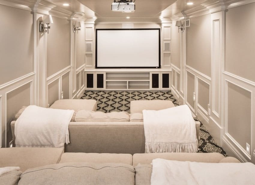 White home theater featuring sectional sofa set on top of the beautiful carpet flooring.